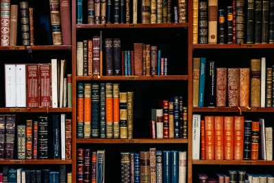 a bookshelf with old books